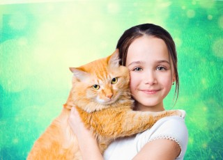 A girl with a big red cat